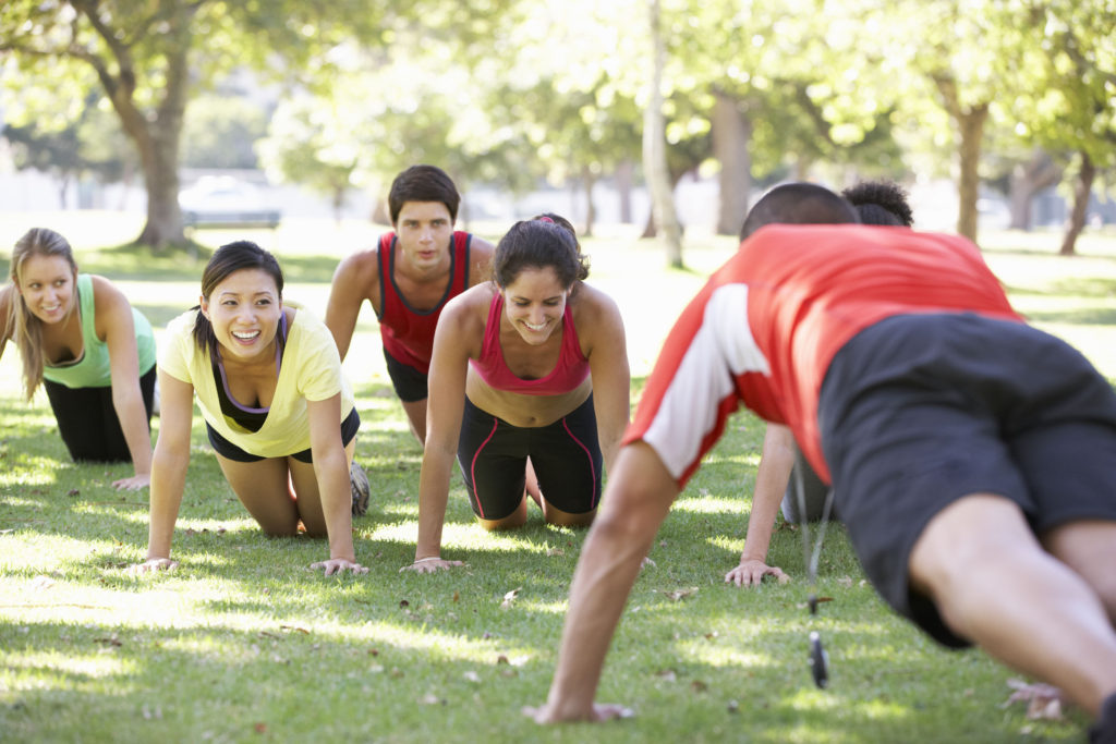 42248149 - instructor running fitness boot camp