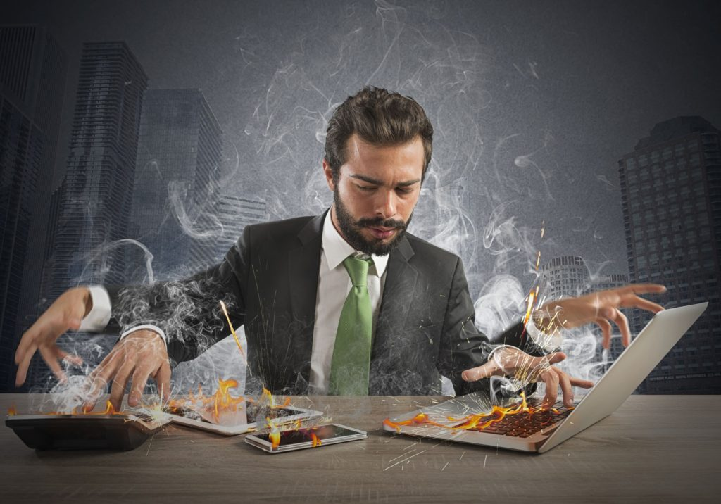 43642131 - stressed businessman working quickly with many computer